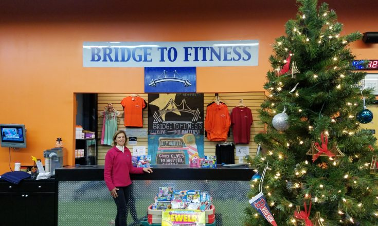 Lisa Cecchi of Bridge to Fitness with some of the many toy donations to the gym benefitting the MLK Jr. Community Center's Santa's Workshop. The toy drive runs until December 12th