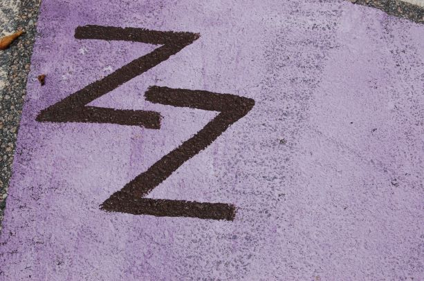 ZZ - Painting project organizer Zobide Zia added her initials to her parking space.