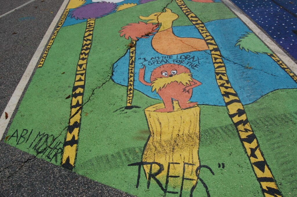 THE ROGERS PARKING LOT as seen before the paintings by the Class of 2020 seniors were covered over by the incoming class, which adopted the project.